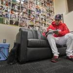 Boston, Ma- October 21, 2018-Stan Grossfeld/ Globe Staff—Practice before Game 1 of World Series-Alex Cora maps out his World Series plans in front of his wall of wins in his office.
