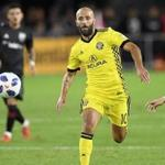Columbus Crew SC forward Federico Higuain (10) chases the ball against D.C. United forward Paul Arriola (7) during the second half of an MLS playoff soccer match, Thursday, Nov. 1, 2018, in Washington. The Crew SC won 2-2 (3-2) in penalty kicks. (AP Photo/Nick Wass)