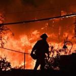 A firefighter was silhouetted by a burning home along Pacific Coast Highway (Highway 1) during the Woolsey Fire in Malibu, Calif.