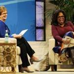 Oprah Winfrey (left) and UMass Lowell Chancellor Jacquie Moloney chatted Thursday at the Tsongas Center in Lowell.