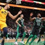 Boston MA 11/17/18 Boston Celtics Kyrie Irving and Marcus Morris battle for a defensive rebound in front of Utah Jazz Rudy Gobert during second quarter action at TD Garden. (photo by Matthew J. Lee/Globe staff) topic: reporter: