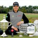 NAPLES, FL - NOVEMBER 18: Ariya Jutanugarn of Thailand poses for a photo with (left to right) the Rolex Player of the Year trophy, Leaders Top 10 Competition Trophy, Vare trophy, Rolex Annika Major award and the Race to the CME Globe trophy after the final round of the LPGA CME Group Tour Championship at Tiburon Golf Club on November 18, 2018 in Naples, Florida. (Photo by Michael Reaves/Getty Images)