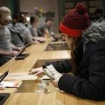 Leicester, MA, 11/19/2018 -- Brittani Beeso, 23, of Worcester purchases marijuana at the opening of Cultivate, one of the state's first two pot shops. This the first day the store can sell recreational marijuana to adults 21 and older. (Jessica Rinaldi/Globe Staff) Topic: 21potopen Reporter: