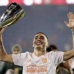 Atlanta United midfielder Miguel Almiron celebrates with the Eastern Conference trophy after the team won the MLS soccer Eastern Conference championship Thursday, Nov. 29, 2018, in Harrison, N.J. The Red Bulls won Thursday's match 1-0, but Atlanta won 3-1 on aggregate. (AP Photo/Julio Cortez)