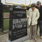 FOR FUTURE HOHLER STORY Myra and Raymond Turner, parents of pro football player Kevin Turner, visit the memorial for their son at the Kevin Turner Field, at the Stanley-Jensen Stadium, Prattville, Alabama. Turner's photograph is on the memorial. Turner's nickname was