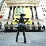 The Fearless Girl statue is unveiled at her new home facing the New York Stock Exchange (NYSE) during an event on December 10, 2018 held by the city of New York and State Street Global Advisors. (Photo by TIMOTHY A. CLARY / AFP)TIMOTHY A. CLARY/AFP/Getty Images