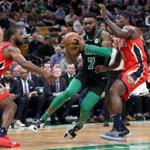 Boston MA 12/10/18 Boston Celtics Jaylen Brown drives to the basket on New Orleans Pelicans Jrue Holiday (right) and Soloman Hill during first quarter action at TD Garden (photo by Matthew J. Lee/Globe staff) topic: 16allschopics reporter:
