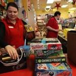Jamaica Plain, MA., 12/12/2018, At the Boing toy store, employees, Deva Jasheway , cq, on left, prepare to wrap and shif gifts. Amid the downfall of Toys