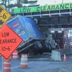 A truck after it became wedged underneath the East Street Railroad Bridge in Westwood Friday morning.