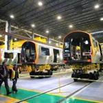 New Orange Line cars on the production floor of CRRC Corp.'s factory in Springfield.