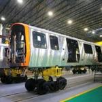 New Orange Line cars on the production floor of the factory in Springfield last month.