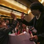 Congresswoman Ayanna Pressley gave high-fives to children on Friday after speaking at a Temple Israel gathering dedicated to the vision of the Rev. Martin Luther King Jr.