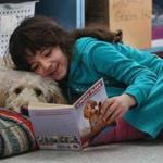 Vivian cuddles with Oscar as she reads to him at the Epstein Hillel School in Marblehead.