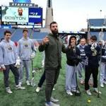 Foxborough 02/15/19 Paul Rabil, one of the founders of the new Premier Lacrosse League chats with Foxboro High School lacrosse players on the field at Gillette Stadium. Photo by John Tlumacki/Globe Staff(sports)