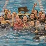 The Wayland girls' swim team jumped into the pool to celebrate its Division 2 championship at Boston University.