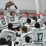 John Hagan (19) and Ryan Nolte lift the trophy after the Bulldogs won the Division 2 South final.