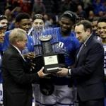 CHARLOTTE, NORTH CAROLINA - MARCH 16: Head coach Mike Krzyzewski of the Duke Blue Devils accepts the ACC Championship trophy after defeating the Florida State Seminoles 73-63 in the championship game of the 2019 Men's ACC Basketball Tournament at Spectrum Center on March 16, 2019 in Charlotte, North Carolina. (Photo by Streeter Lecka/Getty Images)