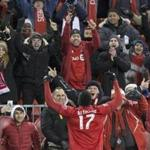Toronto FC forward Jozy Altidore celebrates with fans after scoring against the New England Revolution during the second half of an MLS soccer match Sunday, March 17, 2019, in Toronto. (Chris Young/The Canadian Press via AP)