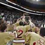 Boston MA 3/17/19 Boston College High players and coaches celebrate their 2-1 victory over Pope Francis High during the fourth overtime period of the MIAA D1A boys' Hockey State Championship at TD Garden. (photo by Matthew J. Lee/Globe staff) topic: reporter: