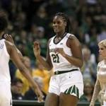 Baylor's DiDi Richards (2), Kalani Brown (21) and Lauren Cox celebrate as they walk to the bench during an NCAA college basketball game against Texas in Waco, Texas, Monday, Feb. 25, 2019. (AP Photo/Tony Gutierrez)