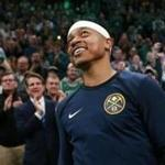 3-18-19: Boston, MA:Former Celtics guard Isaiah Thomas is pictured as his eyes well up a little while he and the fans watch a first quarter video tribute to him on the scoreboard. The Boston Celtics hosted the Denver Nuggets in a regular season NBA basketball game at the TD Garden. (Jim Davis /Globe Staff).