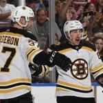SUNRISE, FL - MARCH 23: Brad Marchand #63 is congratulated by Patrice Bergeron #37 of the Boston Bruins after he scored a second period goal against the Florida Panthers at the BB&T Center on March 23, 2019 in Sunrise, Florida. (Photo by Joel Auerbach/Getty Images)