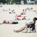 People lay out in the sun on Boston's Carson Beach in the summer of 2018.