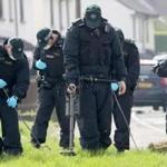 Police officers searched near the scene in the Creggan area of Derry where journalist Lyra McKee was fatally shot.
