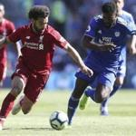 Liverpool's Mohamed Salah and Cardiff City's Bruno Ecuele Manga, right, battle for the ball during the English Premier League soccer match at The Cardiff City Stadium, Cardiff, Wales, Sunday April 21, 2019. (David Davies/PA via AP)