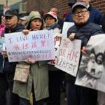 Advocates and residents, both current and former, of Chinatown's Maple Place and Johnny Court, demonstrated Tuesday in an effort to protect historic row houses from developers.