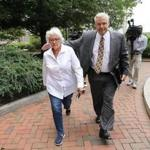 Anne M. Lynch left the courthouse Wednesday with her lawyer after pleading not guilty.