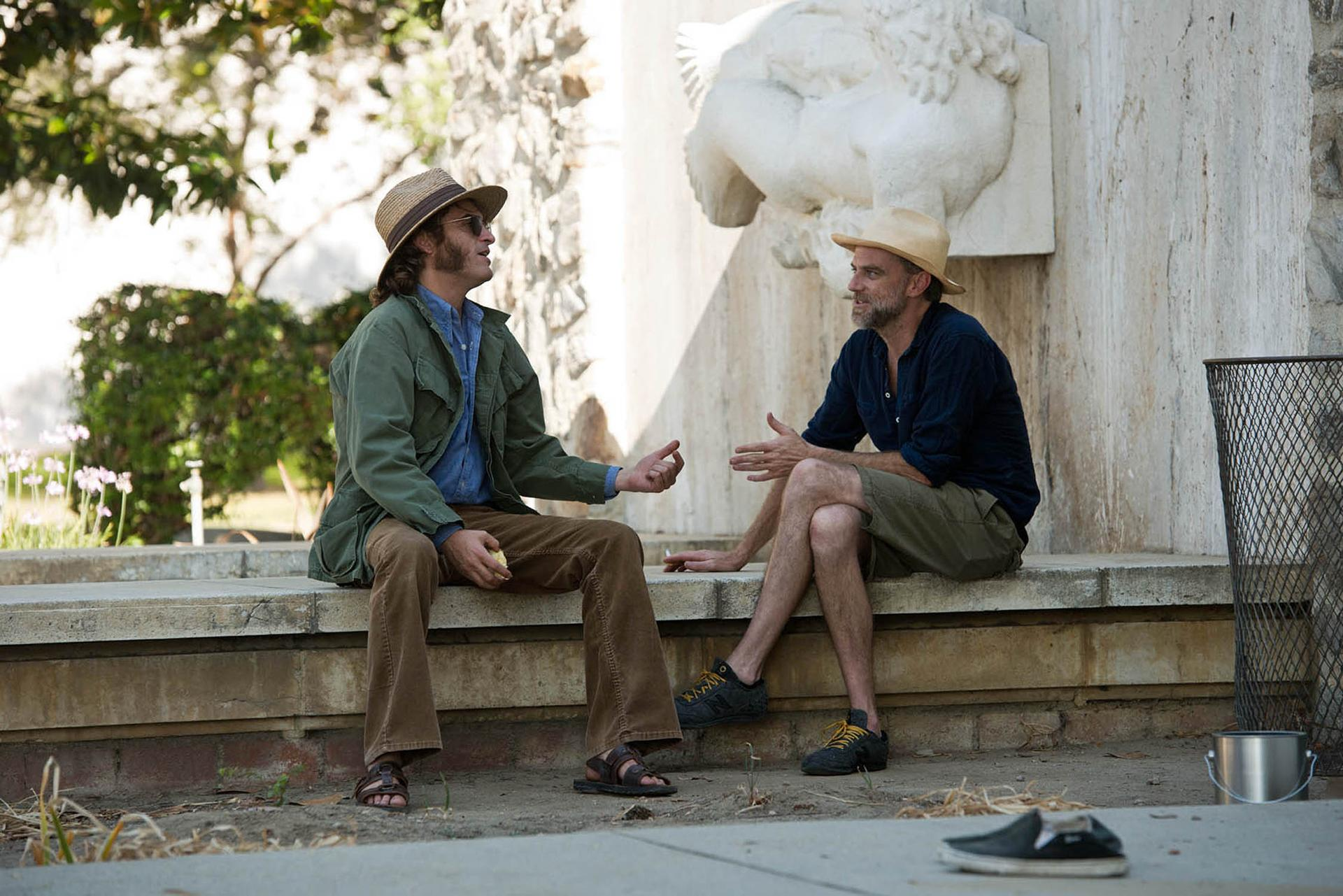 paul thomas anderson tackles inherent vice the boston globe this photo provided by warner bros pictures shows actor joaquin phoenix left