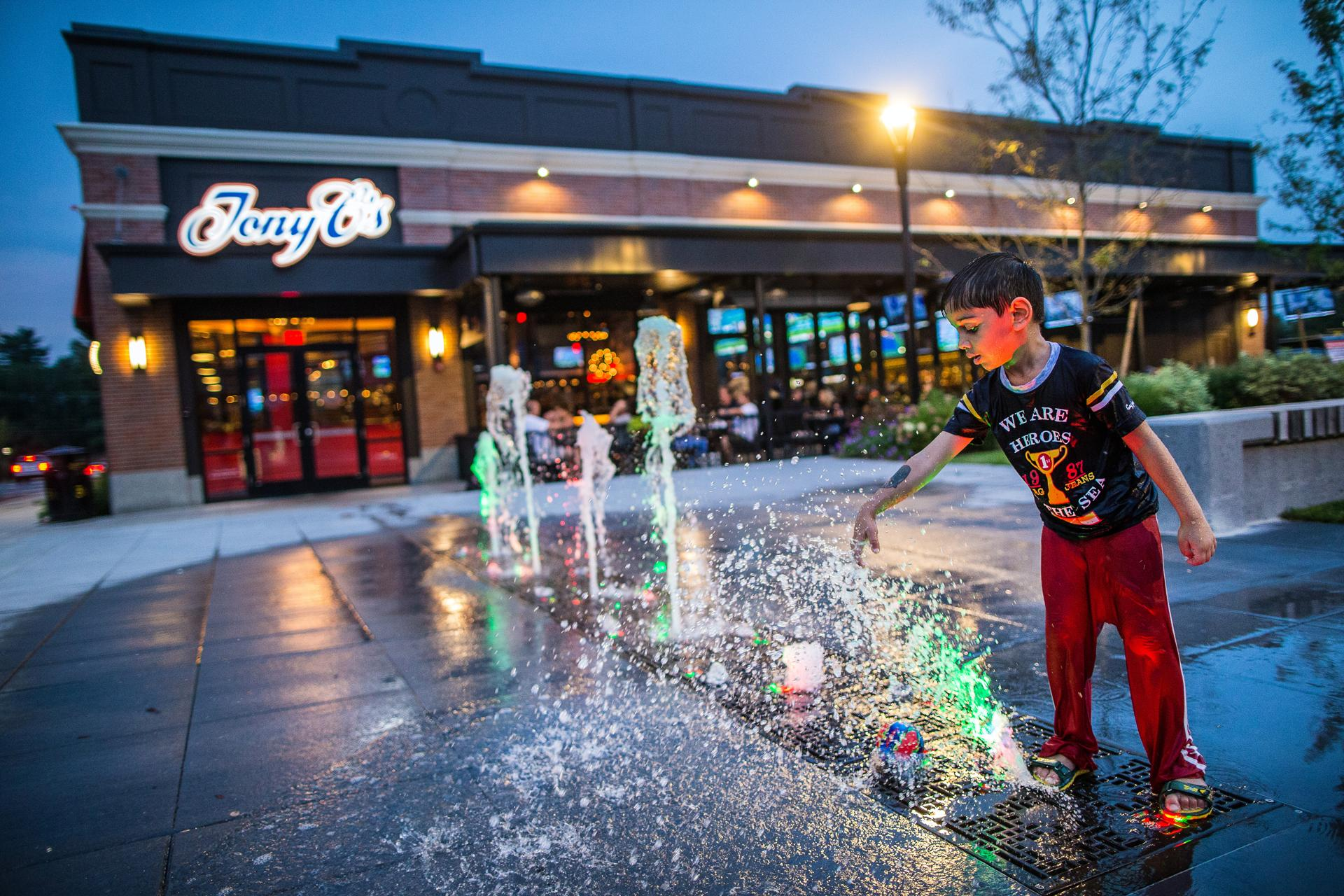 Kartik Jay, 4, of India, played in a fountain outside of Tony C's.