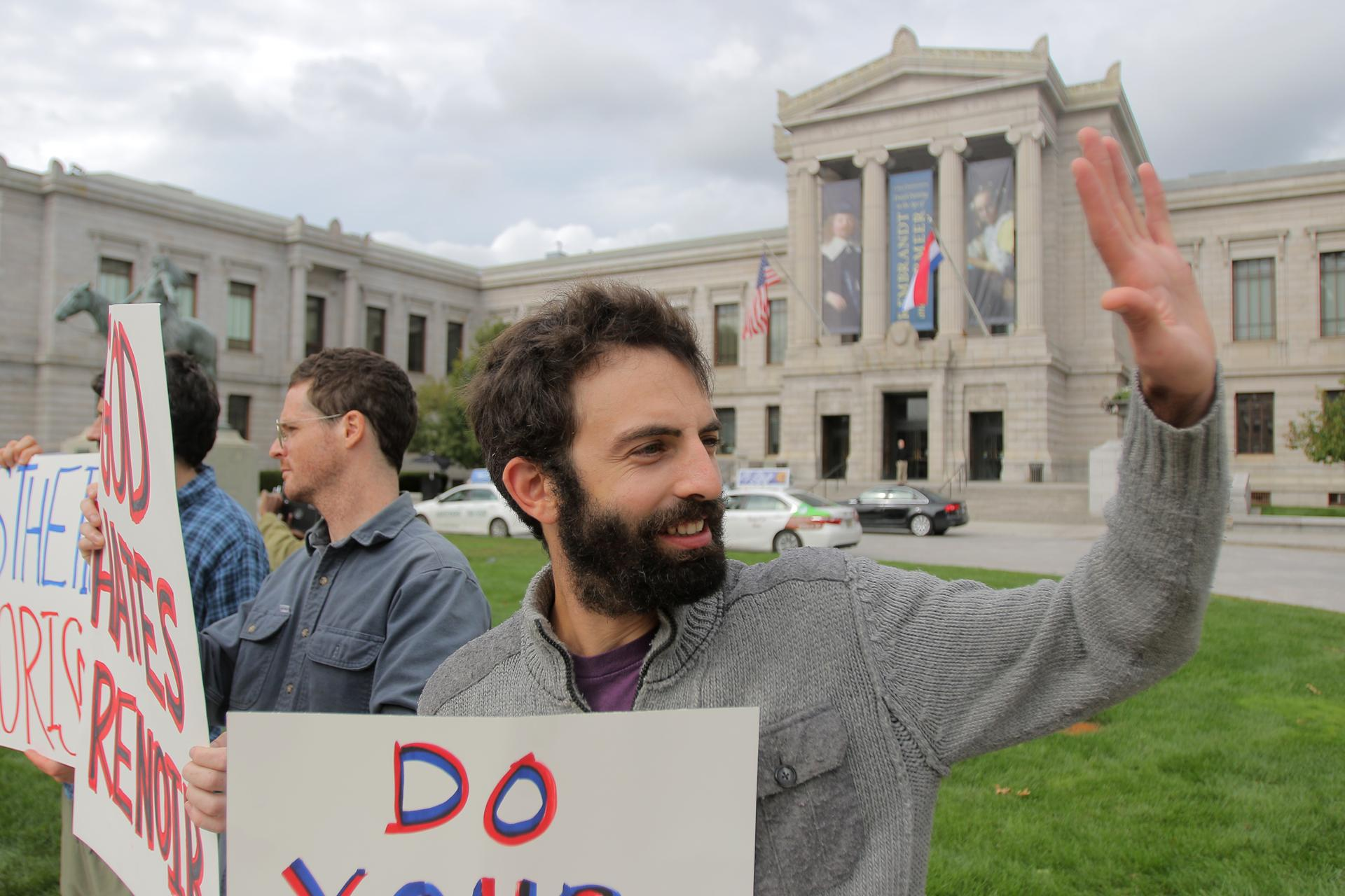 Max Geller (foreground) and other protesters outside the Museum of Fine Arts in Boston.