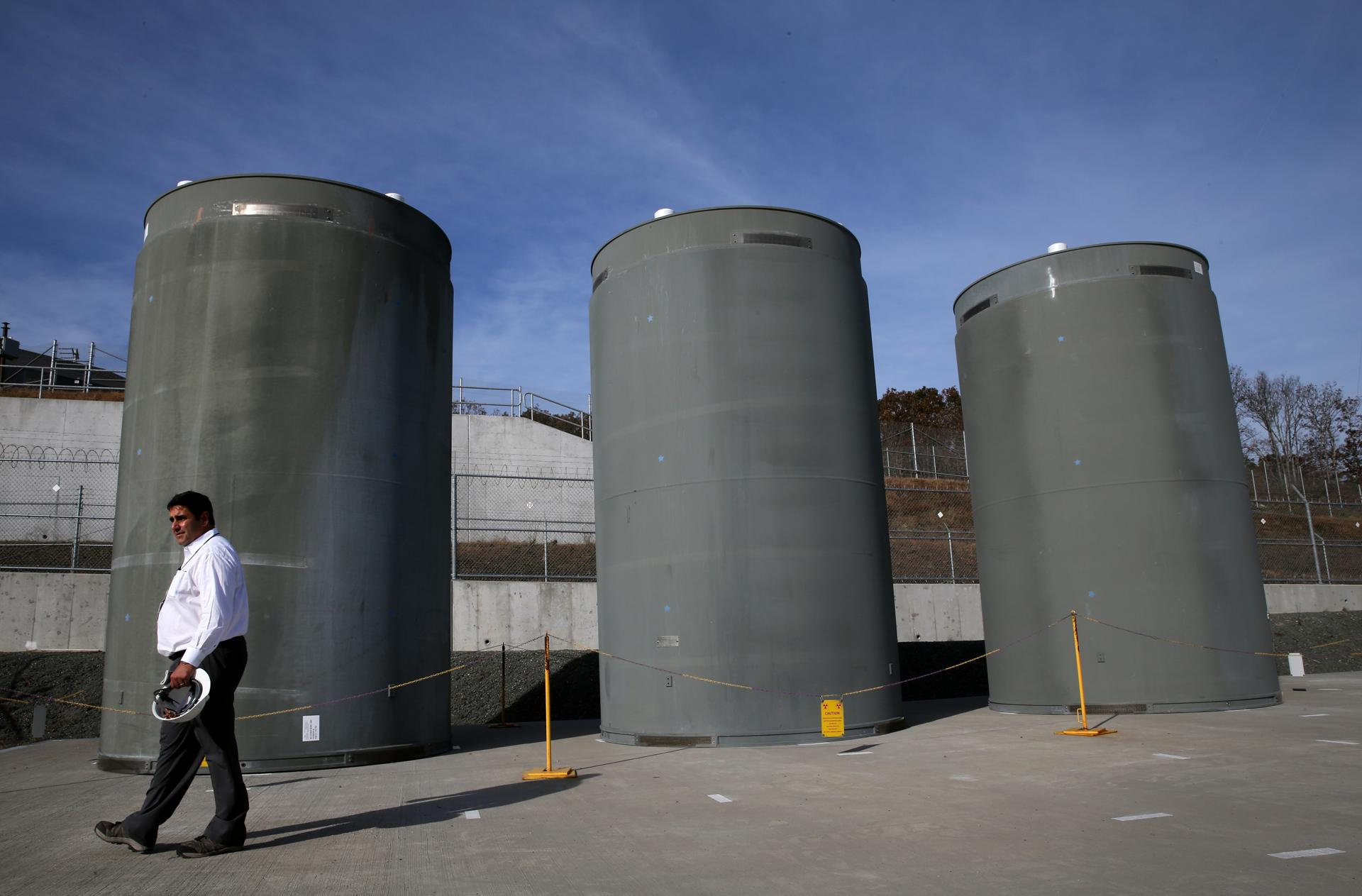 David Noyes of Entergy walked past dry cask storage units last week during a tour of the Pilgrim nuclear plant.