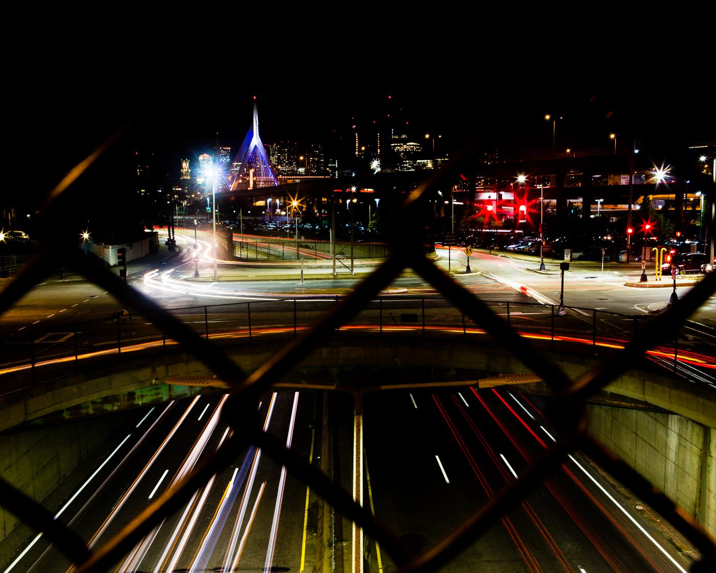 crossing boston a photo essay of the city s lasting impression the zakim bridge traffic zooming as seen from bunker hill community college pedestrian