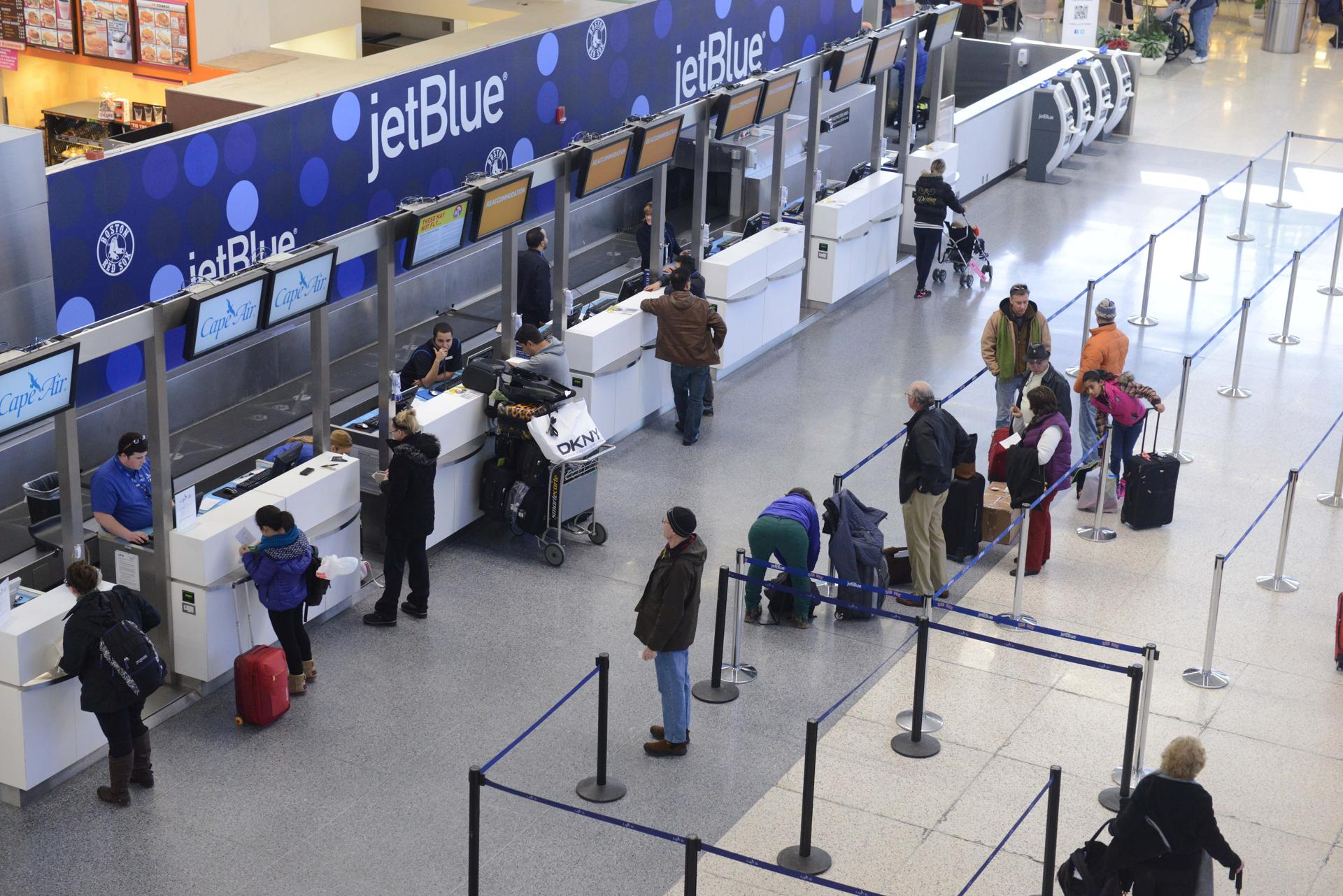 Passengers Waited To Check In At Jetblue's Kiosks At Logan Airport