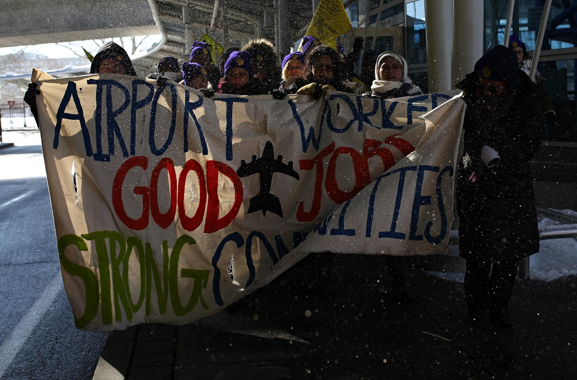 The protesters were seeking wages of at least $15 per hour for service-industry jobs such as checking bags or cleaning terminals and airplanes.