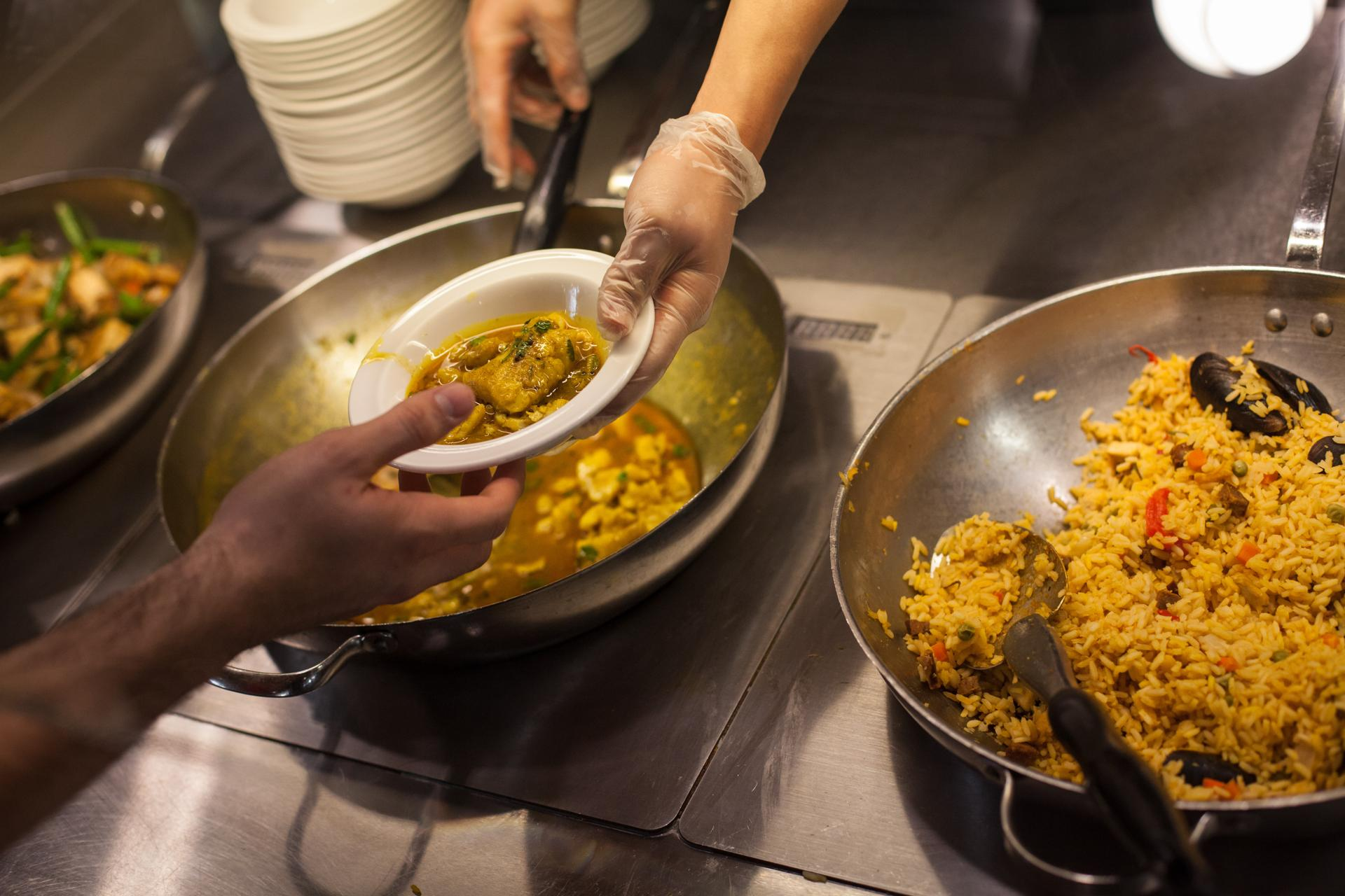 A student served fish curry made with locally sourced red fish in the hampshire