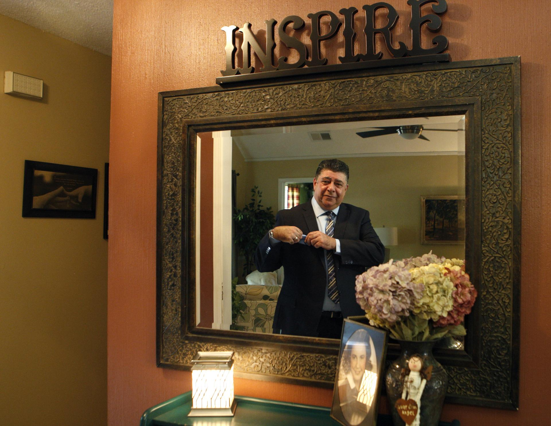 Esposito checked himself in a mirror before leaving for church.