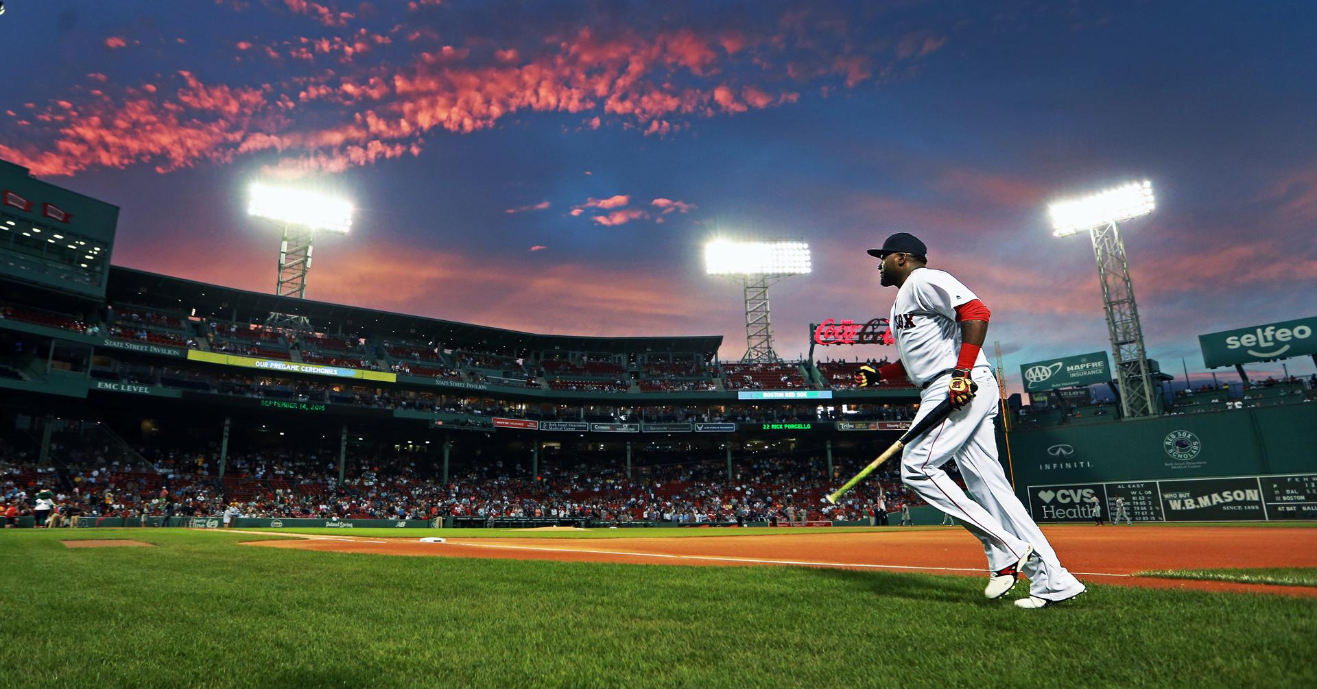 09/14/16: Boston, MA: Red Sox DH David Ortiz will soon be riding off into the sunset as far as his major league baseball career is concerned, tonight he is just heading back into the dugout as the sun sets over Fenway Park after finishing some pre game warmups. The Boston Red Sox hosted the Baltimore Orioles in a regular season MLB baseball game at Fenway Park. (Globe Staff Photo/Jim Davis) section: metro topic: Red Sox-Orioles