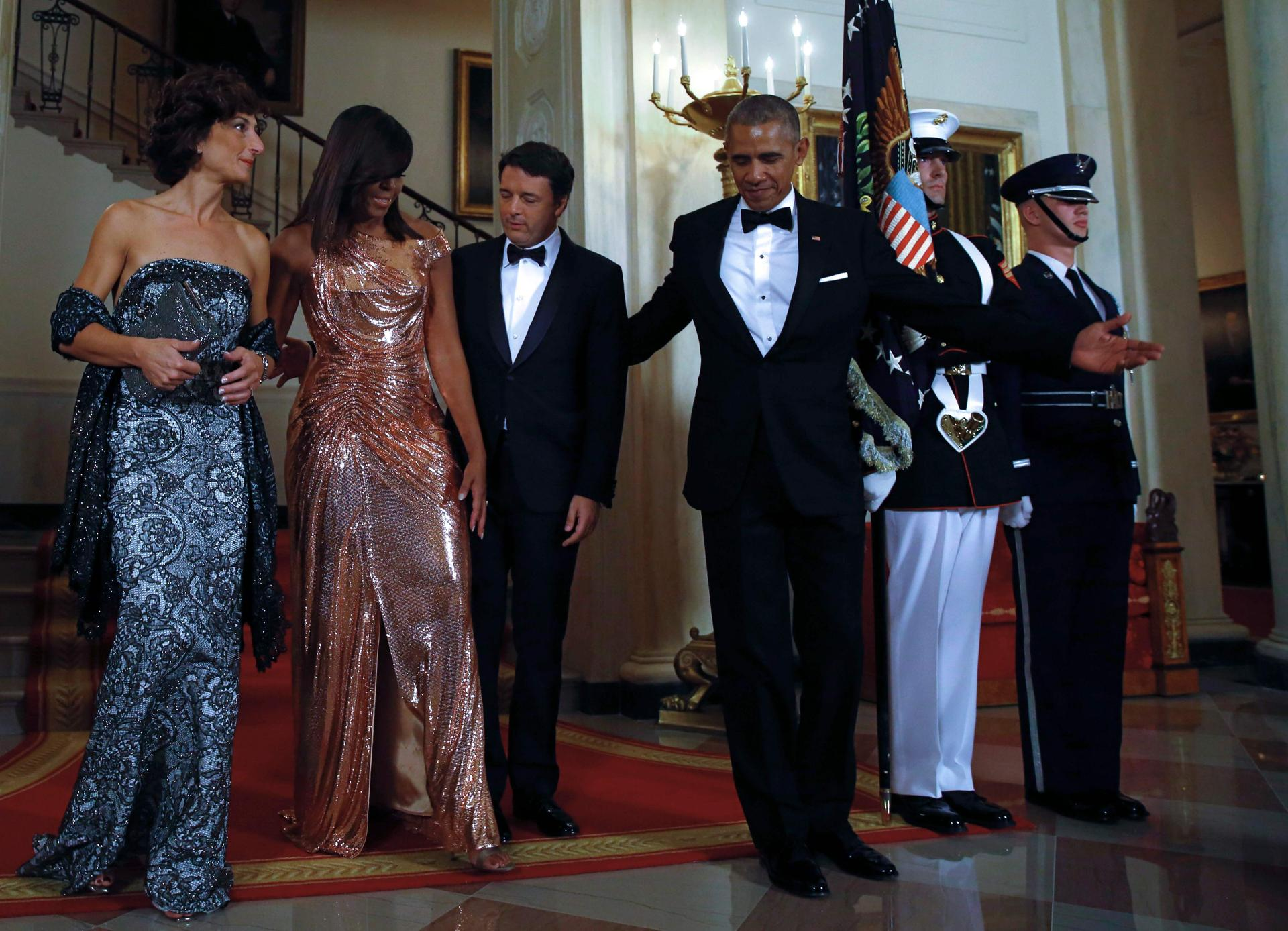 Us president barack obama r and first lady michelle obama 2nd l