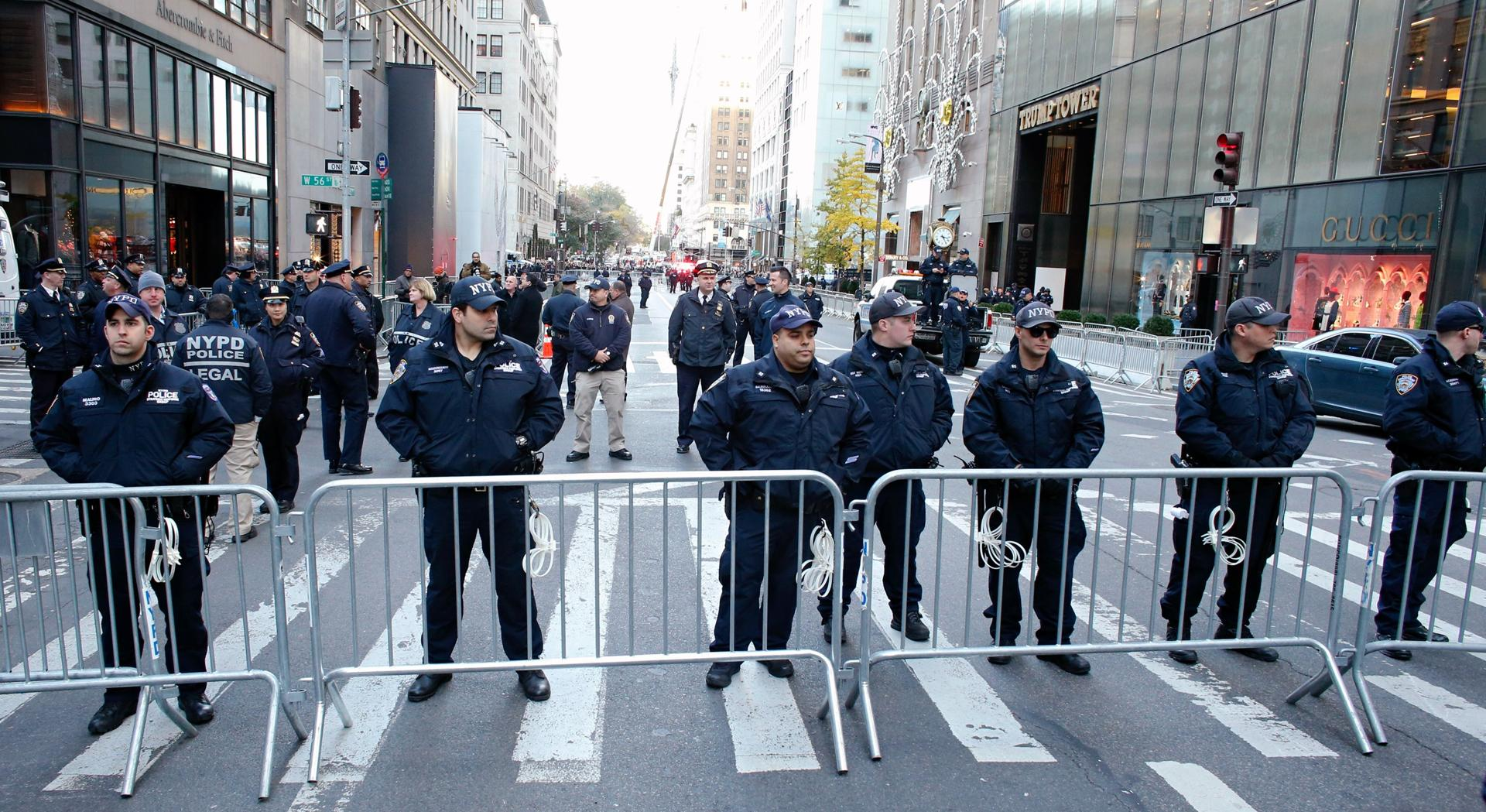New York police officers blocked the street during a protest againts US president-elect Donald Trump in front of Trump Tower on Saturday.