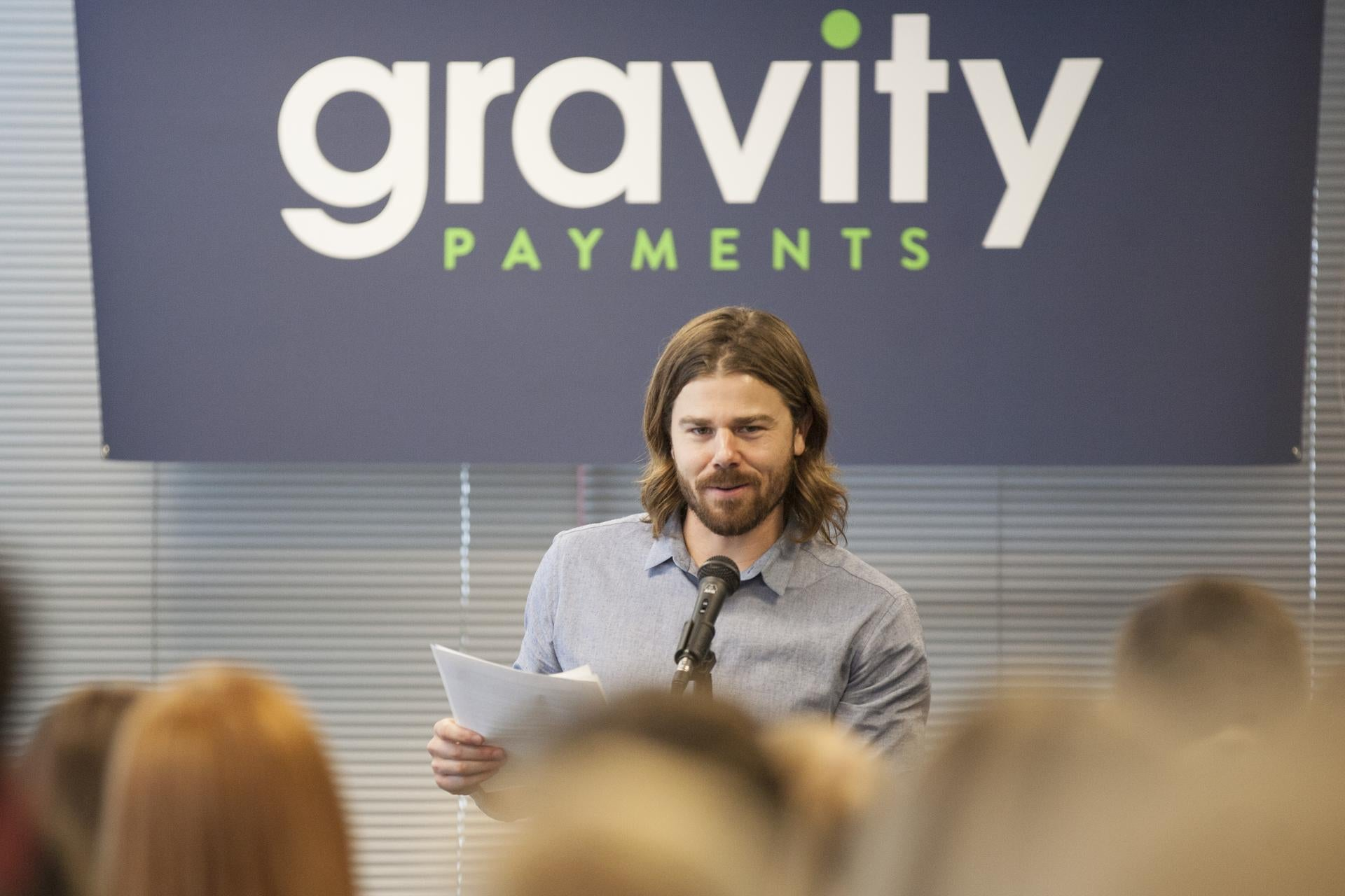 Dan Price, chief executive of Gravity Payments, announces a plan to his employees that will raise the company's minimum wage to $70,000 a year within two years, at offices in Seattle, April 13, 2015. While the overwhelming majority of the responses on social media and elsewhere to Price's decision to set a minimum wage of $70,000 a year at his company were positive, there were also a number of skeptics and naysayers. (Matthew Ryan Williams/The New York Times)