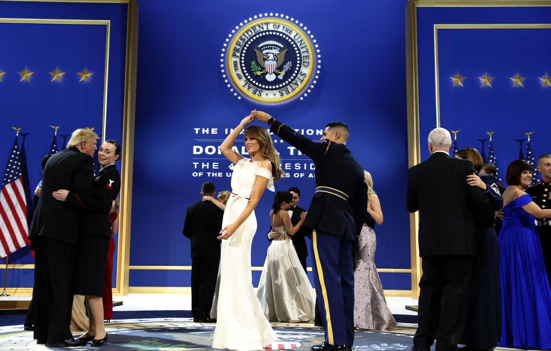 The latest trumps dance with military members at final ball daily mail - President Donald Trump Left Dances With Navy Petty Officer 2nd Class Catherine Cartmell As