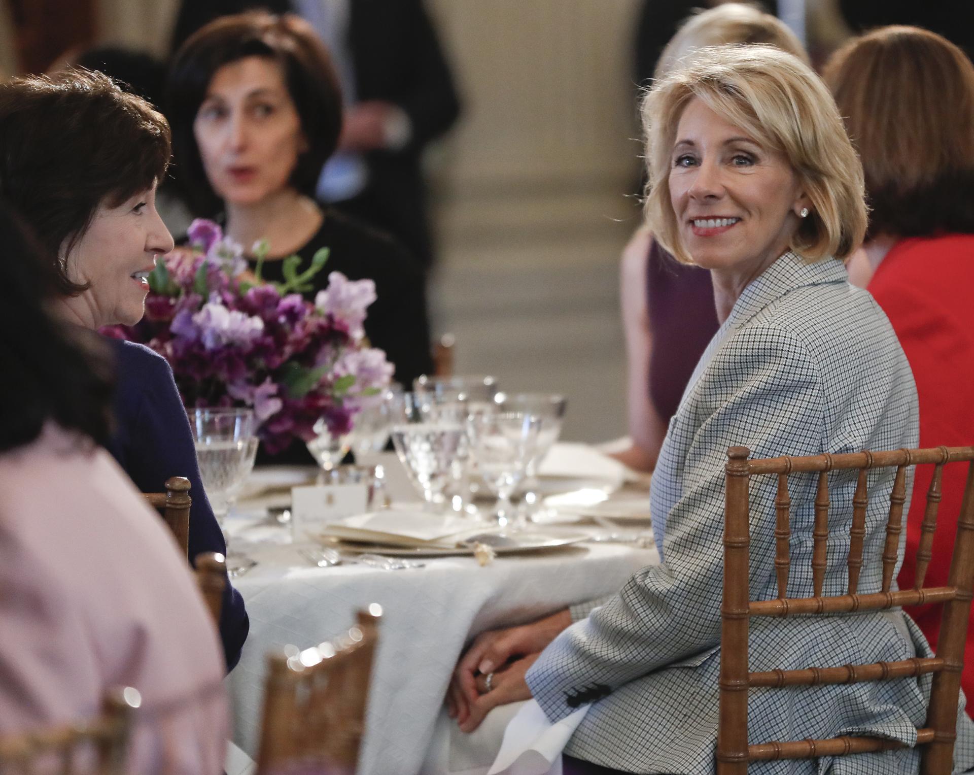 Hasil gambar untuk President Trump has lunch with Vice President Pence and Secretary of Education Betsy DeVos