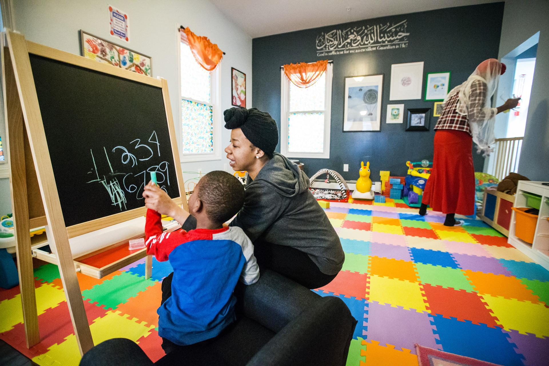 04/26/2017 BOSTON, MA Resident Samyha (cq) and her son Jeremyha (cq) 5, play together at The Amal Women's Center in Boston. (Aram Boghosian for The Boston Globe)