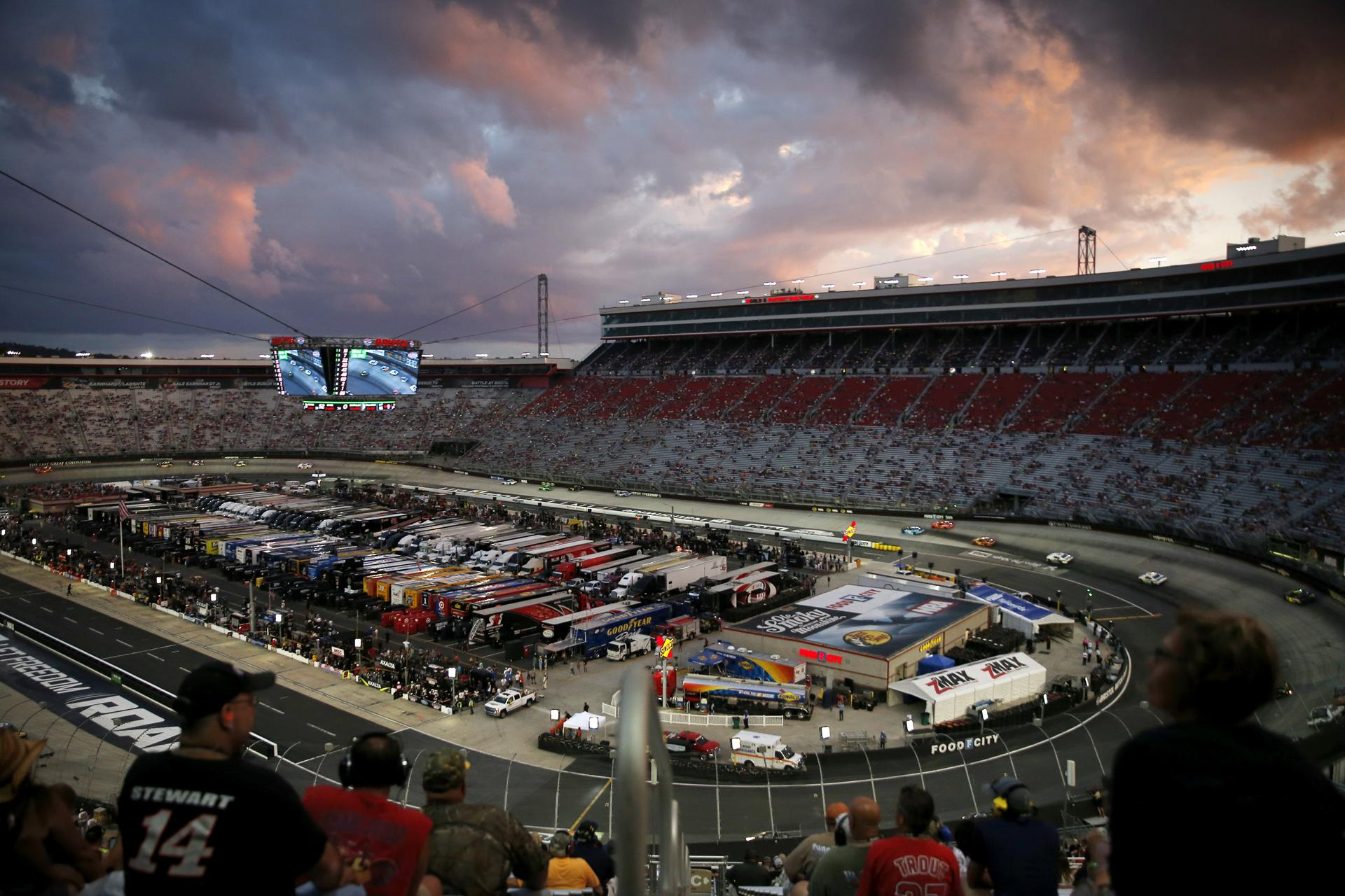 Bristol, TN -- 8/18/2017 - Fans watch the Bass Pro Shops NRA Night Race Qualifying Race as the sun sets over Bristol Motor Speedway. (Jessica Rinaldi/Globe Staff) Topic: 21NASCAR Reporter: Annie Linskey