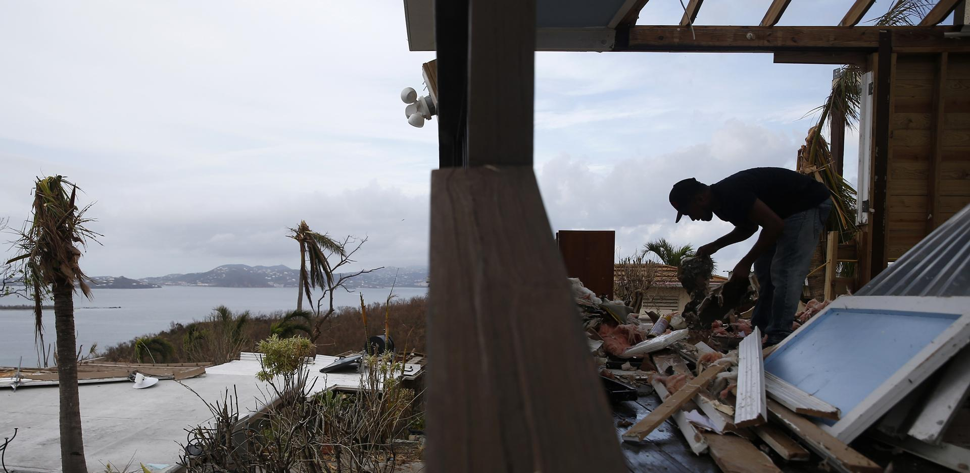 Cruz Bay, St. John -- 9/14/2017 - William de Leon sorts through the remnants of an office on Estate Lindholm destroyed by Hurricane Irma, a hotel in the Cruz Bay section of St. John. (Jessica Rinaldi/Globe Staff) Topic: Reporter: