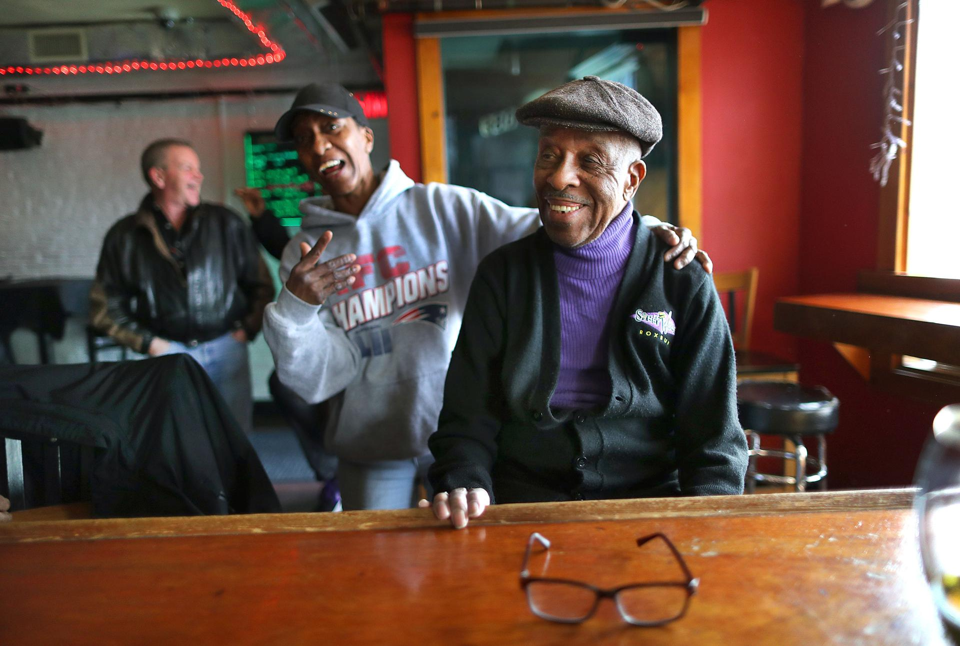 "Kim Jackson (left) greeted Arthur ""Sonny"" Walker, 92, who opened the bar that now bears his name nearly 50 years ago."